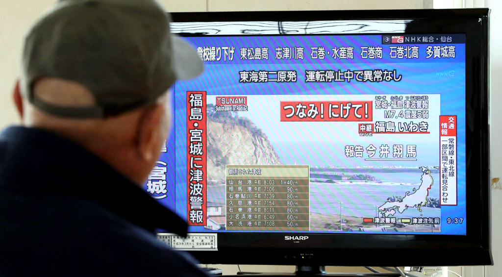 News of tsunami warnings for Fukushima and Miyagi prefectures is shown on TV at a shelter in Sendai, Japan, on Nov. 22, 2016, after a powerful earthquake shook the country's northeast. (Photo by Kyodo News via Getty Images)